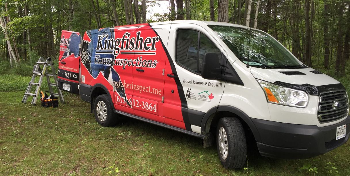Kingfisher Home Inspections blue, red, and white van with equipment in behind